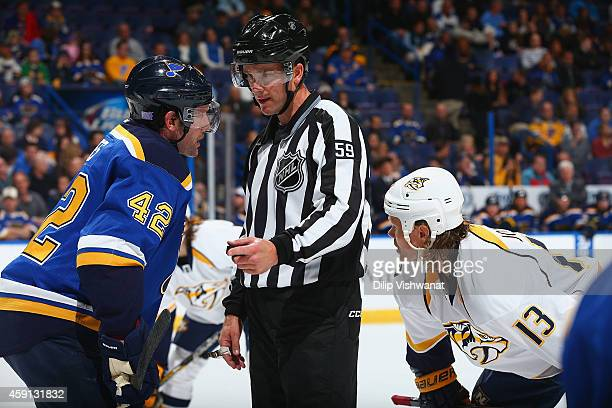 David Backes the St Louis Blues talks to linesman Steve Barton at the Scottrade Center on November 13 2014 in St Louis Missouri