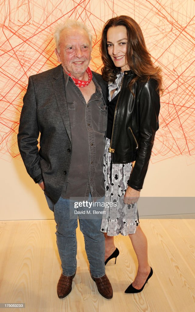 David Bailey (L) and Catherine Bailey attend a private view of 'HUGO: Red Never Follows', celebrating 20 years of Hugo Boss, at the Saatchi Gallery on July 30, 2013 in London, England.