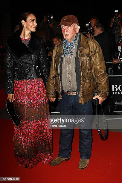 David Bailey and wife Catherine Dyer attend the GQ Men Of The Year Awards at The Royal Opera House on September 8 2015 in London England
