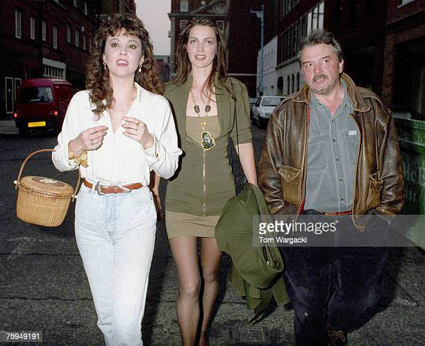 David Bailey with wife Catherine Dyer and exwife Marie Helvin arrive at Hamiltons Gallery on June 5th 1990 in London