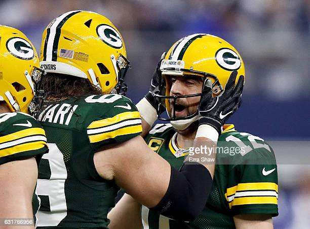 David Bakhtiari and Aaron Rodgers of the Green Bay Packers celebrate after scoring a touchdown in the first half during the NFC Divisional Playoff...