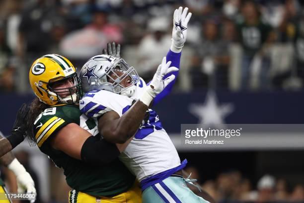 David Bakhtiari of the Green Bay Packers blocks Dorance Armstrong of the Dallas Cowboys in the game at ATT Stadium on October 06 2019 in Arlington...