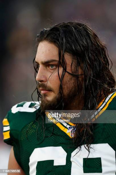 David Bakhtiari of the Green Bay Packers looks on from the sidelines in the first half of a preseason game against the Baltimore Ravens at MT Bank...