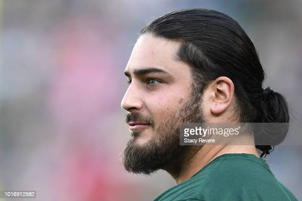 David Bakhtiari of the Green Bay Packers watches action during warmups prior to a preseason game against the Tennessee Titans at Lambeau Field on...