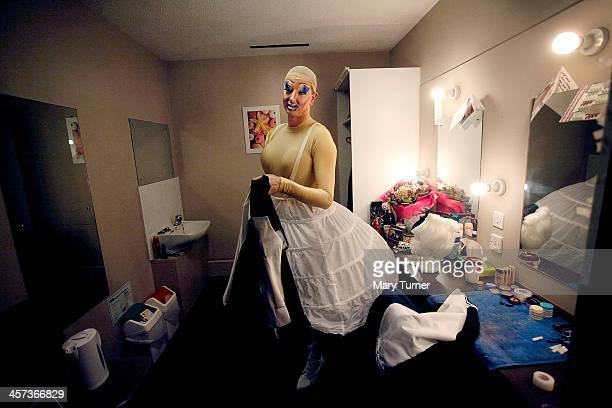 David Ball gets into his Ugly Sister's dress in his dressing room at the Churchill Theatre on December 12 2013 in Bromley England David a former...