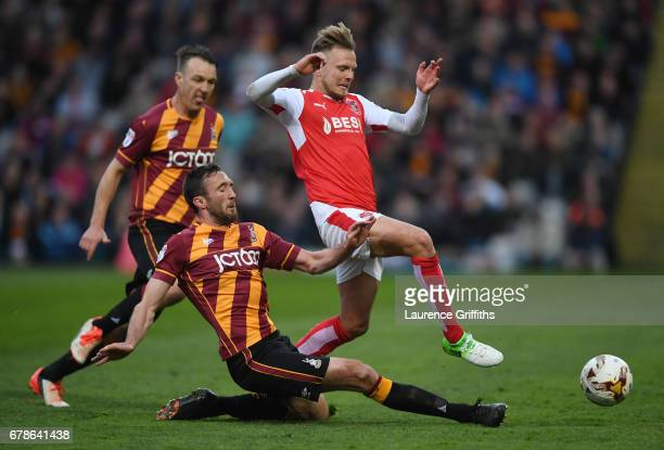 David Ball of Fleetwood Town is tackled by Rory McArdle of Bradford City during the Sky Bet League One playoff semi final first leg match between...