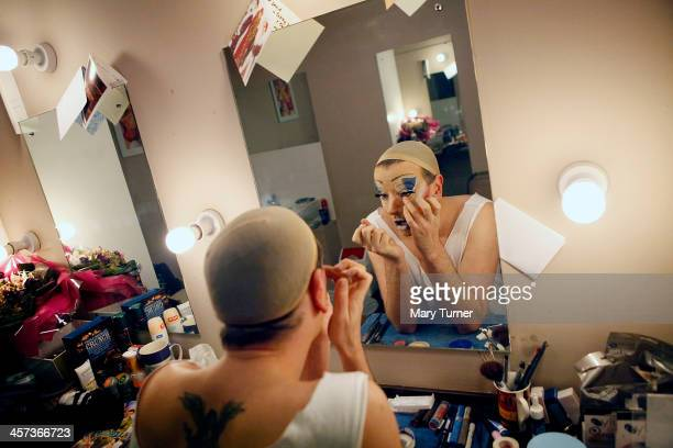 David Ball paints his face to transform himself into Lily, one of Cinderella's Ugly Sisters, at the Churchill Theatre on December 12, 2013 in...