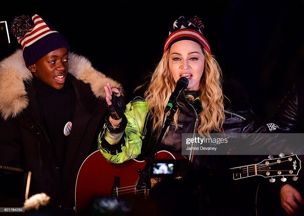 David Banda and Madonna perform a surprise concert at Washington Square Park in support of Hillary Clinton on November 7, 2016 in New York City.