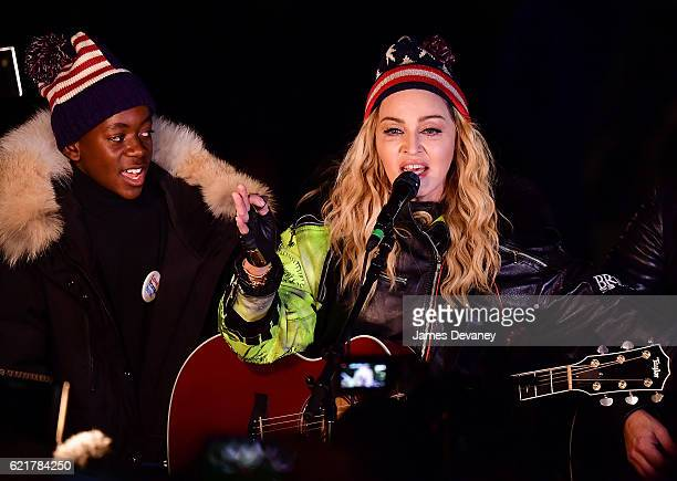 David Banda and Madonna perform a surprise concert at Washington Square Park in support of Hillary Clinton on November 7 2016 in New York City