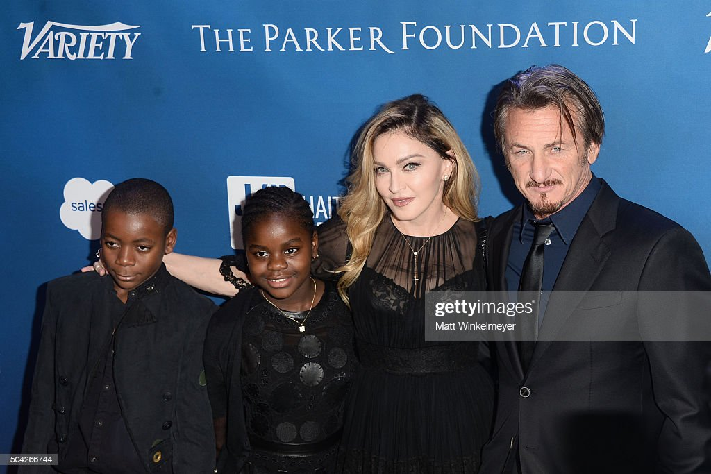 David Banda, Mercy James, musician Madonna, and actor Sean Penn arrive at the 5th Annual Sean Penn & Friends HELP HAITI HOME Gala benefiting J/P Haitian Relief Organization at Montage Hotel on January 9, 2016 in Beverly Hills, California.