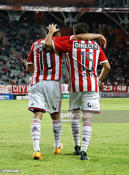 David Barbona of Estudiantes celebrates with Ezequiel Cerutti after scoring his team's first goal during a match between Estudiantes and Temperley as...