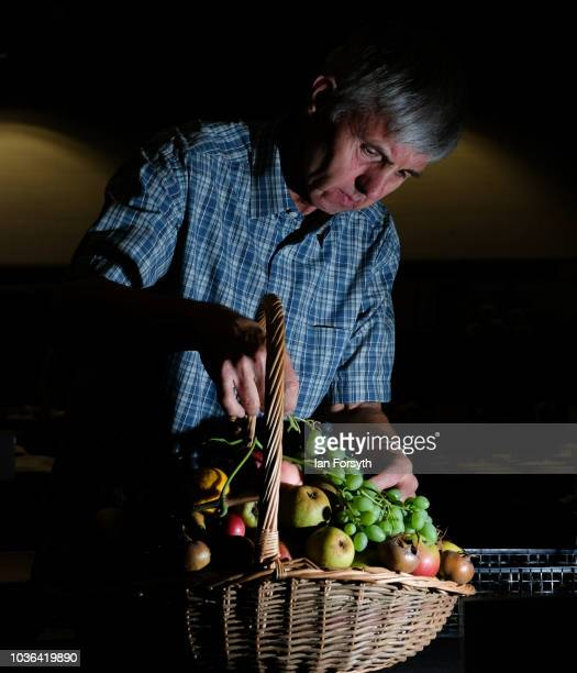 David Barker from Selby prepares the Head Gardner's Basket from Middlethorpe Hall ahead of judging on the first day of the Harrogate Autumn Flower...