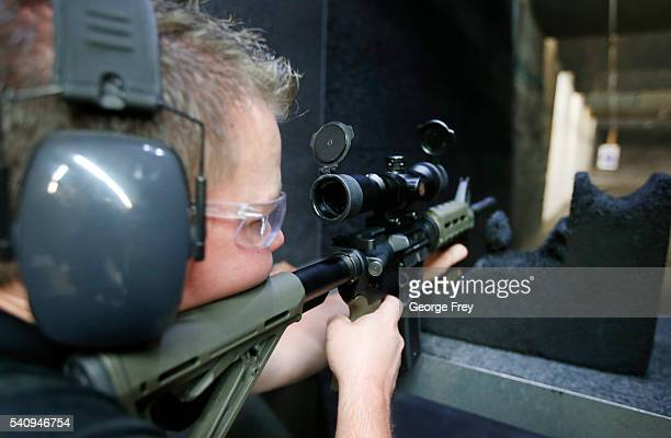 David Barker test fires an AR15 semiautomatic gun at Action Target on June 17 2016 in Springville Utah Semiautomatics are in the news again after the...