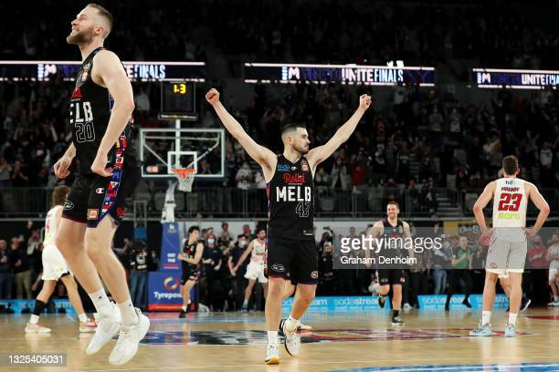 David Barlow and Chris Goulding of Melbourne United celebrate victory during game three of the NBL Grand Final Series between Melbourne United and...