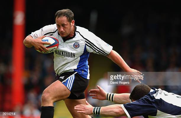David Barnes of Bath holds off a challenge during the Zurich Premiership match between Bristol Shoguns and Bath on May 4 2003 at Ashton Gate in...