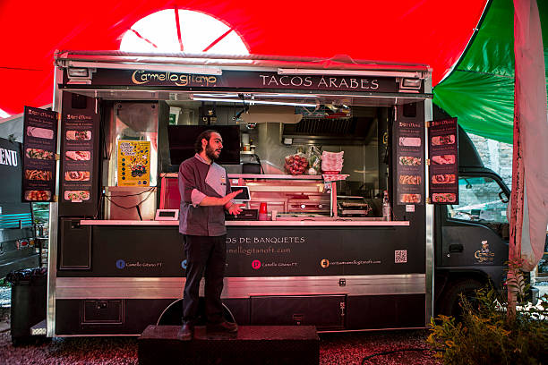 David Barquet Owner And Chef Of The Camello Gitano Lebanese Food Truck Waits For