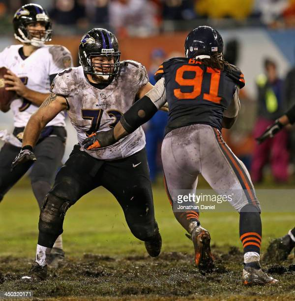 David Bass of the Chicago Bears rushes against Marshal Yanda of the Baltimore Ravens at Soldier Field on November 17 2013 in Chicago Illinois The...