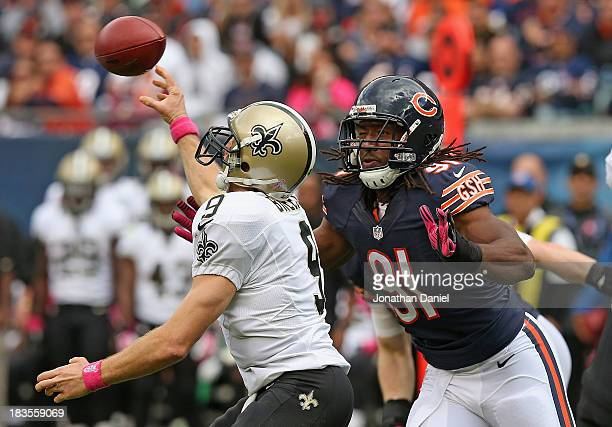 David Bass of the Chicago Bears rushes to Drew Brees of the New Orleans Saints at Soldier Field on October 6 2013 in Chicago Illinois The Saints...