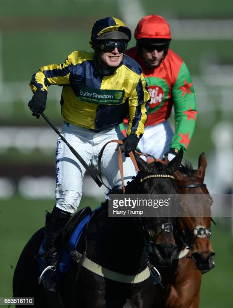 David Bass on board Willoughby Court celebrate after victory in the Neptune Investment Management Novices Hurdle Race during Ladies Day of the...