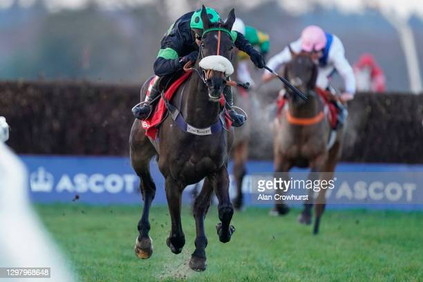 David Bass riding First Flow clear the last to win The Matchbook Betting Exchange Clarence House Chase at Ascot Racecourse on January 23, 2021 in...