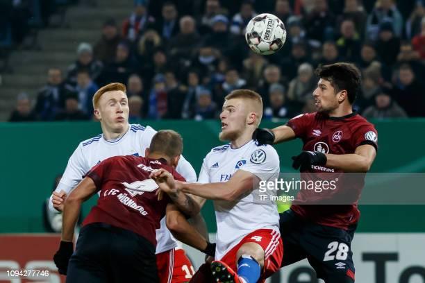 David Bates of Hamburger SV Ewerton of 1 FC Nuernberg Rick van Drongelen of Hamburger SV and Lukas Muehl of 1 FC Nuernberg battle for the ball during...