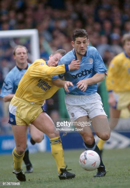 David Batty of Leeds United holds onto David White of Manchester City during a Barclays League Division One match at Maine Road on April 4 1992 in...