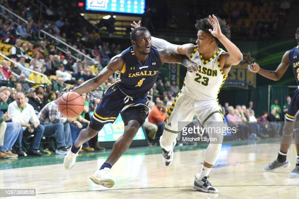 David Beatty of the La Salle Explorers dribbles up Javon Greene of the George Mason Patriots during a college basketball game at the Eagle Bank Arena...