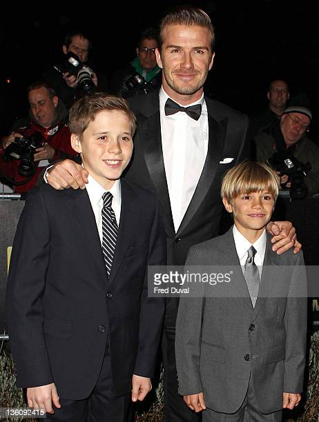 David Beckam with sons Brooklyn Beckham and Romeo Beckham attend The Sun Military Awards at Imperial War Museum on December 19, 2011 in London,...