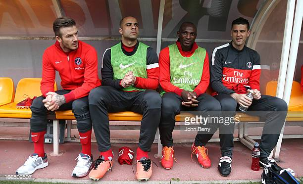 David Beckham Alex Dias Da Costa Zoumana Camara and Thiago Motta of PSG look on before the start of the Ligue 1 match between ES Troyes Aube...