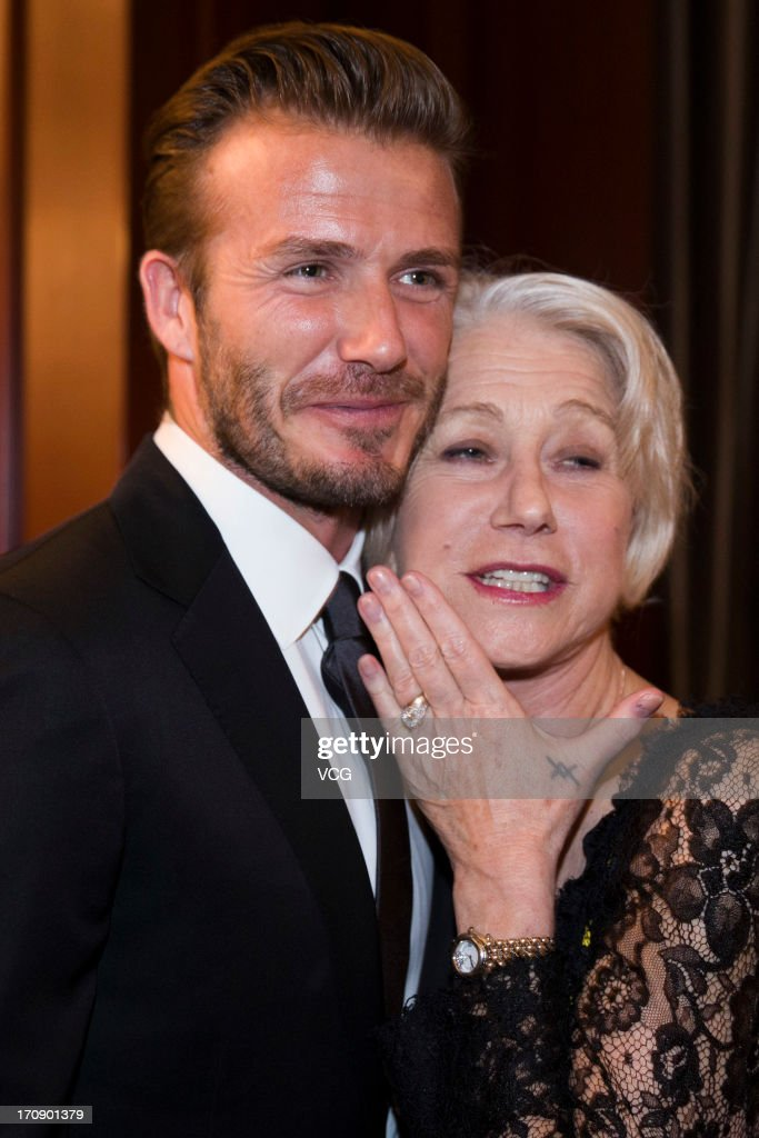David Beckham and actress Helen Mirren pose as they attend business event on June 19, 2013 in Shanghai, China.