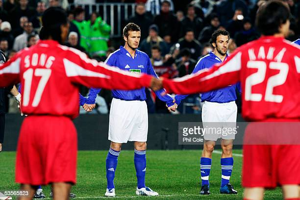 David Beckham and Allessandro Del Piero of the Shevshenko XI join hands and observe a minutes silence with Rigobert Song and Kaka of Ronaldinho's XI...