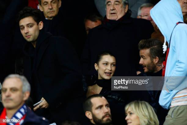 David Beckham and Bella Hadid are seen during the UEFA Champions League round of 16 2nd leg football match between Paris SaintGermain FC and Real...