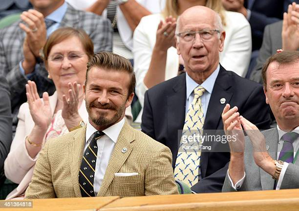 David Beckham and Bobby Charlton attend the Mikhail Kuskushkin v Rafael Nadal match on centre court during day six of the Wimbledon Championships at...