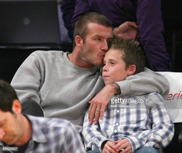 David Beckham and Brooklyn Beckham attends the Los Angeles Lakers vs Houston Rockets game at the Staples Center on November 9 2008 in Los Angeles...
