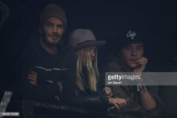 David Beckham and Brooklyn Beckham wait for the Foo Fighters to perform on day 3 of the Glastonbury Festival 2017 at Worthy Farm Pilton on June 24...