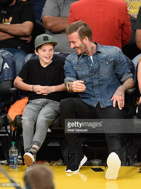 David Beckham and Cruz Beckham attend a basketball game between the Boston Celtics and the Los Angeles Lakers at Staples Center on April 3 2016 in...