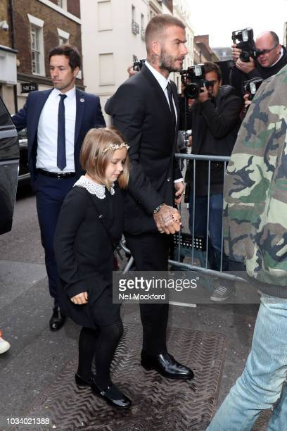 David Beckham and daughter Harper Beckham arrive to attend the Victoria Beckham show at Galerie Thaddaeus Ropac during London Fashion Week September...