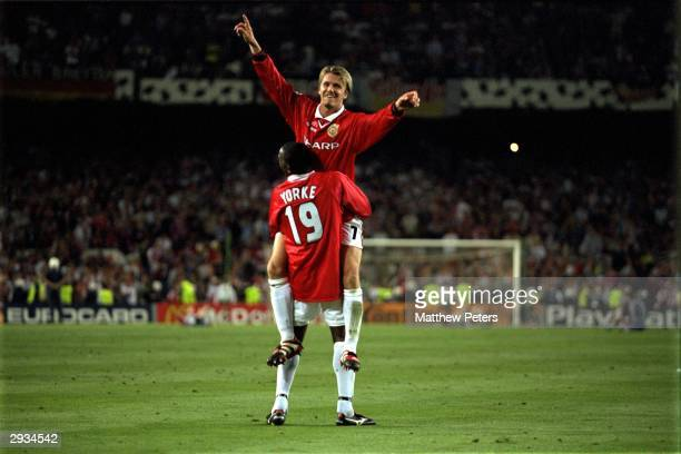 David Beckham and Dwight Yorke celebrate after victory in the UEFA Champions League Final between Bayern Munich v Manchester United at the Nou camp...