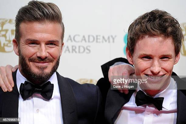 David Beckham and Eddie Redmayne pose in the winners room at the EE British Academy Film Awards at The Royal Opera House on February 8 2015 in London...