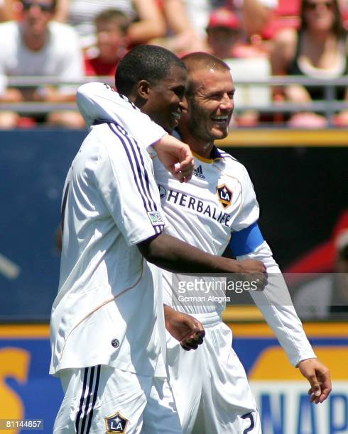 David Beckham and Edson Buddle of the Los Angeles Galaxy celebrate Buddle's goal against FC Dallas during the game at Pizza Hut Park on May 18 2008...