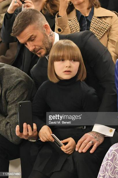 David Beckham and Harper Beckham attend the Victoria Beckham show during London Fashion Week February 2019 at Tate Britain on February 17, 2019 in...
