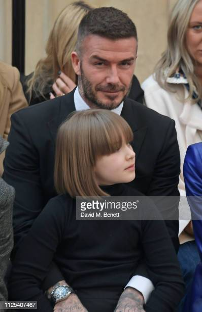 David Beckham and Harper Beckham attend the Victoria Beckham show during London Fashion Week February 2019 at Tate Britain on February 17 2019 in...