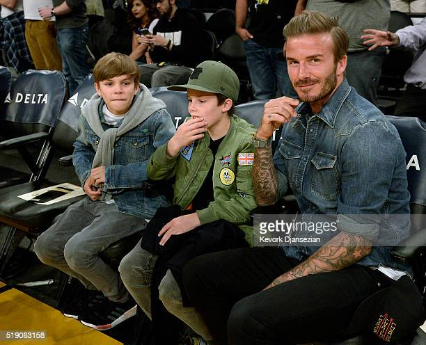 David Beckham and his children Romeo Beckham and Cruz Beckham attend a basketball game between the Boston Celtics and the Los Angeles Lakers at...