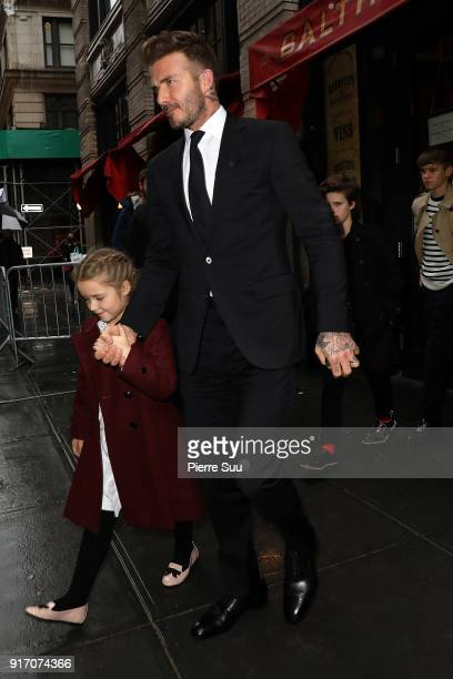 David Beckham and his daughter Harper comes out of 'Balthazar' restaurant where the Beckham family had lunch after Victoria Beckham's show on...