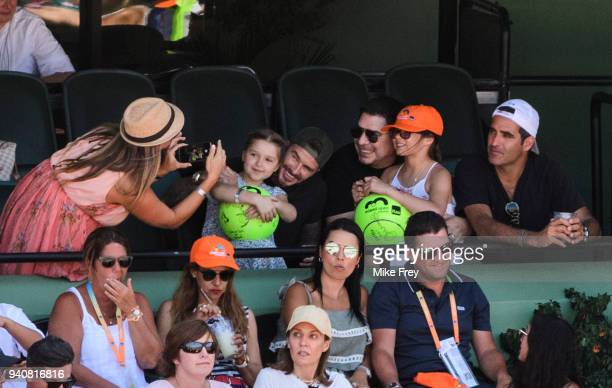 David Beckham and his daughter Harper watching John Isner of the USA against Zverev of Germany 6-7 6-4 6-4 in the men's final on Day 14 of the Miami...