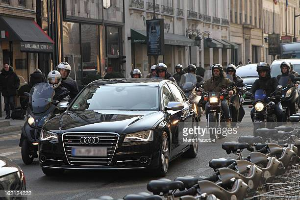 David Beckham and his son Brooklyn are surrounded by photographers as they are on their way to the PSG training camp at on February 19 2013 in Paris...
