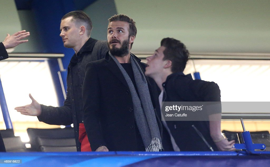 David Beckham and his son Brooklyn Beckham attend the UEFA Champions League match between Chelsea FC and Paris Saint-Germain FC at Stamford Bridge stadium on March 11, 2015 in London, England, United Kingdom.