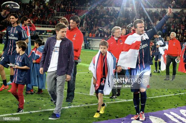 David Beckham and his son of Paris SaintGermain celebrate after defeating Stade Brestois 29 at the French League 1 match at Parc des Princes on May...