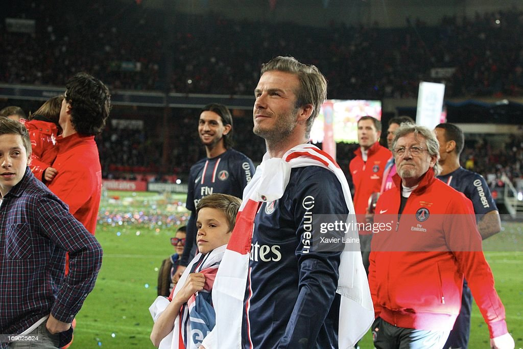 aab6371c2 David Beckham and his son of Paris Saint-Germain celebrate after ...