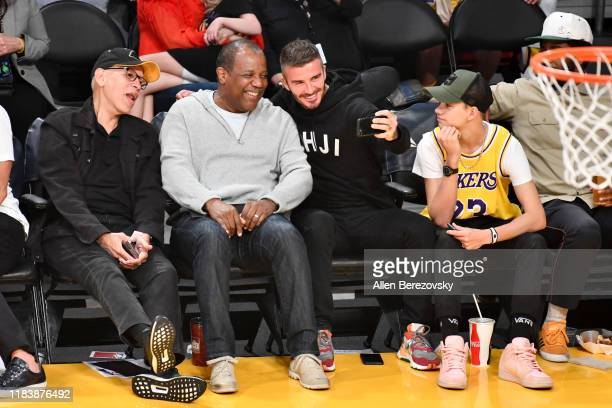 David Beckham and his son Romeo Beckham attend a basketball game between the Los Angeles Lakers and the Charlotte Hornets at Staples Center on...